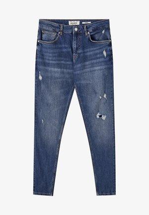 PREMIUM-KAROTTENJEANS MIT ZIERRISSEN 05684525 - Jeans slim fit - mottled dark blue