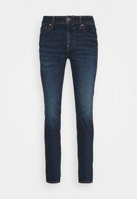 CLEAN - Slim fit jeans - dark wash
