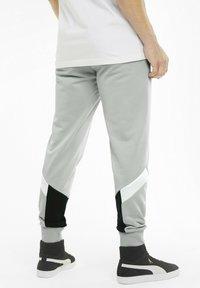Puma - Tracksuit bottoms - grey - 1