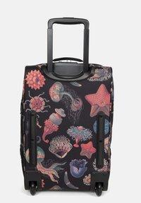Eastpak - TRANVERZ  - Wheeled suitcase - save our oceans - 2