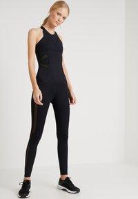 Daquïni - FLUXUS - Leggings - Trousers - black - 1