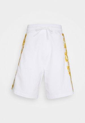 PRINT LOGO BAROQUE - Tracksuit bottoms - white