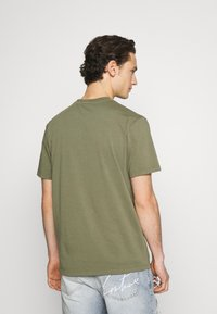 WAWWA - JUNGLE LOGO UNISEX - Print T-shirt - khaki green - 2