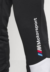 Puma - BMW TRACK PANTS - Tracksuit bottoms - black - 4