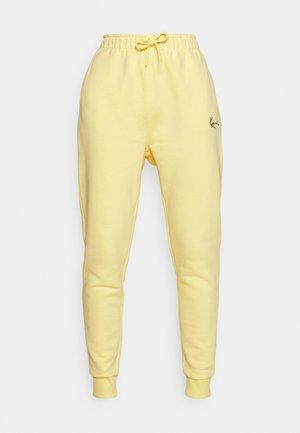 SIGNATURE SWEATPANTS LIGHT - Tracksuit bottoms - yellow