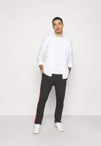 Nominal - CHECK TROUSER - Trousers - black - 1