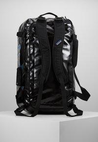 Patagonia - BLACK HOLE DUFFEL 55L UNISEX - Sports bag - black - 5