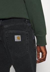 Carhartt WIP - PONTIAC PANT MAITLAND - Straight leg jeans - black stone washed - 6