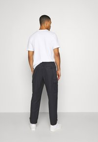 Nike Sportswear - Träningsbyxor - black/white - 2