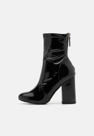 COSY - Kotníková obuv na vysokém podpatku - black
