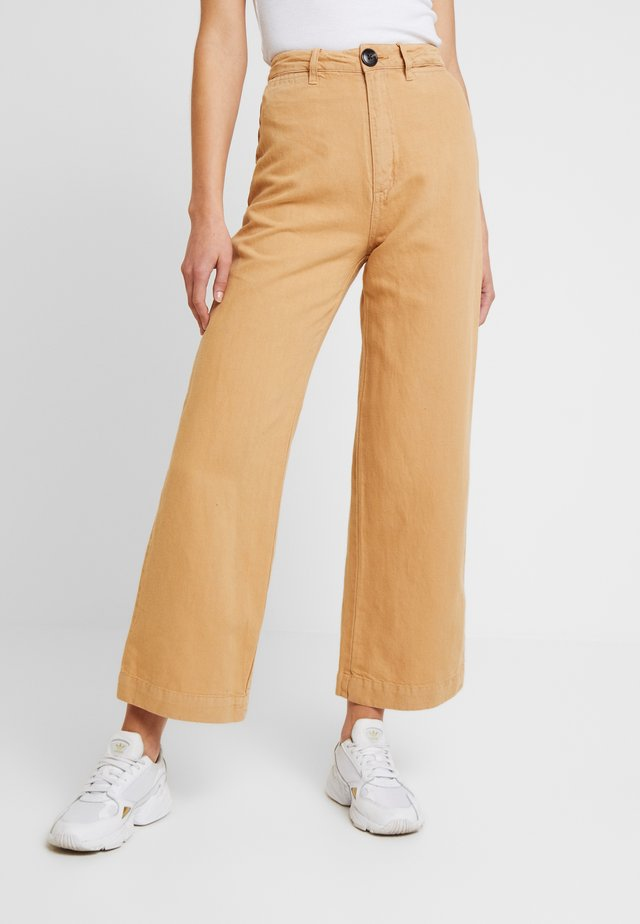 OLD MATE PANT - Straight leg jeans - gold