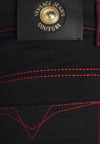 Versace Jeans Couture - COAL - Slim fit jeans - black - 2