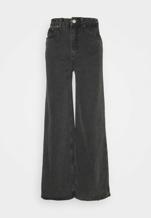 PUDDLE JEAN - Flared jeans - black