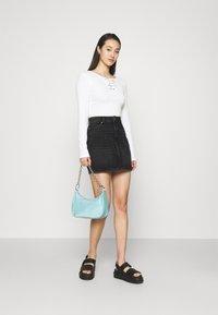 ONLY - ONLROSE LIFE ASHAPE SKIRT - Mini skirt - black denim - 1