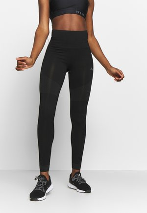 ONPJAMINA CIRCULAR - Leggings - black