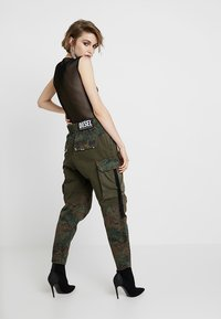 Diesel - THENA TROUSERS - Trousers - olive - 2