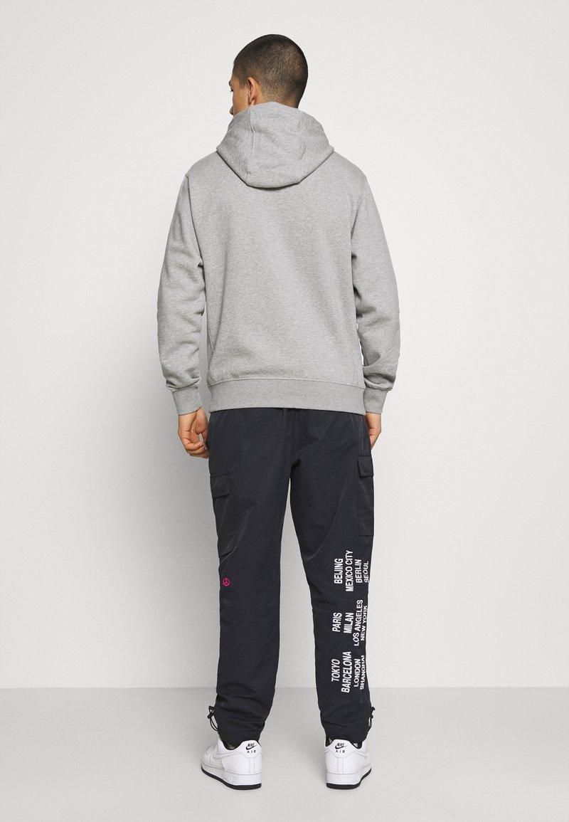 Nike Sportswear - PANT - Cargo trousers - black