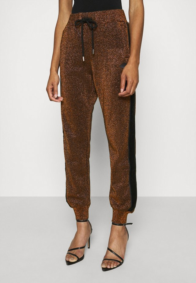 PANTS - Tracksuit bottoms - copper