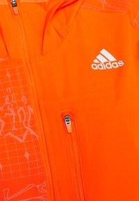 adidas Performance - OWN THE RUN WIND RESPONSE  - Sports jacket - app signal orange/reflective silver - 2