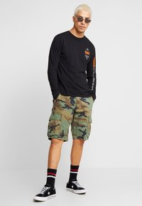 Levi's® Extra - GRAPHIC TEE - Camiseta de manga larga - black - 1