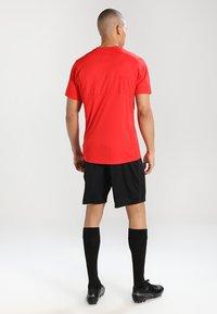 Puma - LIGA  - Sports shirt - red/white - 2