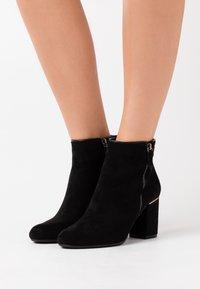 XTI - Ankle boots - black - 0