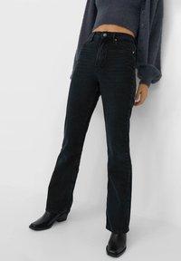 Stradivarius - VINTAGE - Flared Jeans - black - 0
