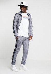 Night Addict - CHECK - Pantaloni sportivi - black/white - 1