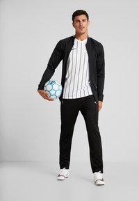 Lotto - DELTA PANT - Spodnie treningowe - all black - 1