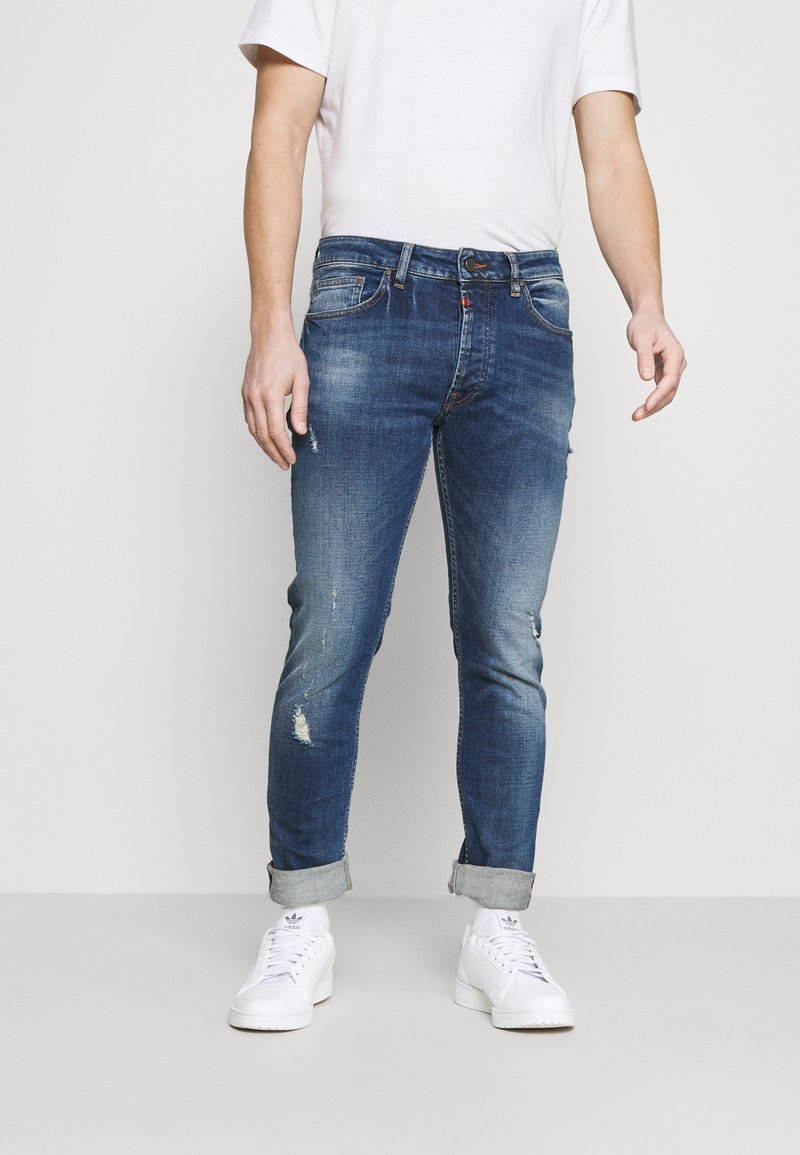 Tigha - MORTEN REPAIRED - Slim fit jeans - mid blue
