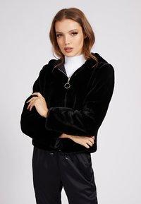 Guess - Winter jacket - schwarz - 0