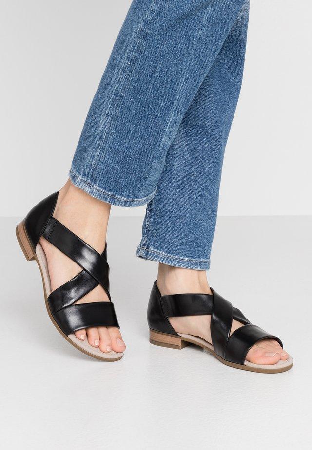 Sandaalit nilkkaremmillä - schwarz