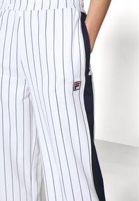 Fila - HALA TRACK PANTS - Trousers - blanc de blanc/black iris - 3