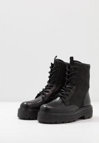 Tommy Jeans - FLATFORM BOOT - Platform ankle boots - black - 4