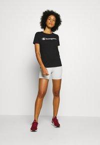 Champion - CREWNECK - T-shirts med print - black - 1