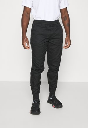 RELAXED CUFFED TRAINER - Pantalones cargo - dark black