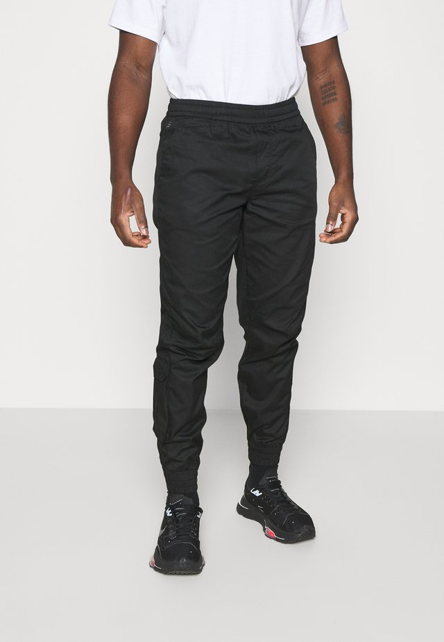 RELAXED CUFFED TRAINER - Cargo trousers - dark black