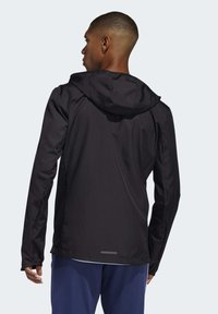 adidas Performance - OWN THE RUN HOODED WINDBREAKER - Training jacket - black - 1