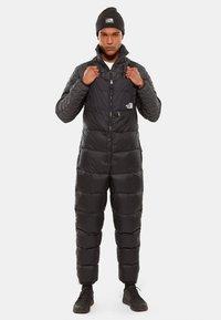 The North Face - M NUPTSE BIB - Pantalones - tnf black - 0