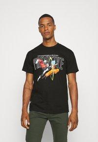 Primitive - SUPER BATTLE - Print T-shirt - black - 0