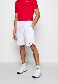 Nike Performance - Sports shorts - white/black - 0