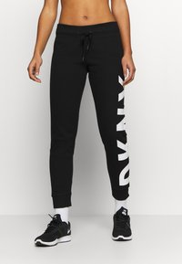 DKNY - EXPLODED LOGO CUFFED - Tracksuit bottoms - black - 0