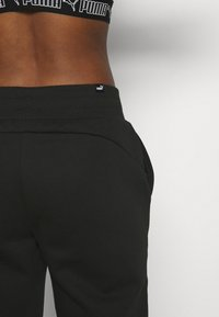 Puma - Pantalon de survêtement - black - 5