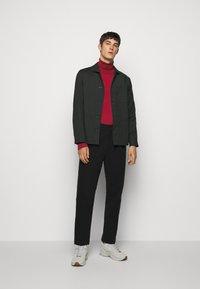 J.LINDEBERG - LYD - Stickad tröja - chili red - 1
