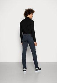 Replay - ANBASS HYPERFLEX - Slim fit jeans - blue - 2