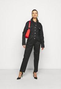 Missguided Petite - COATED CINCHED WAIST BOILERSUIT - Jumpsuit - black - 1