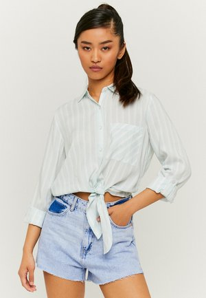 MIT KNOTEN - Button-down blouse - green