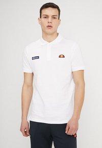 Ellesse - MONTURA - Polo shirt - white - 0
