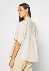 Monki - LUCA BLOUSE - Button-down blouse - beige - 2
