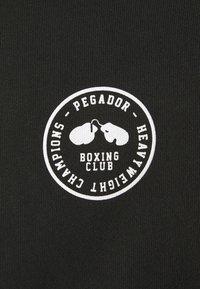 Pegador - MIKE HOODIE UNISEX USED LOOK - Mikina skapucí - vintage black - 6
